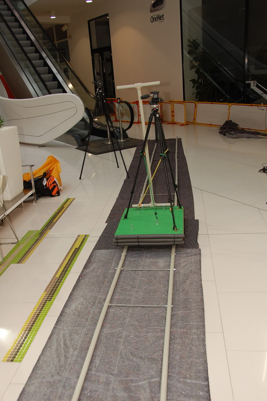 Camera dolly on rails with carpet below to smooth out the movement.