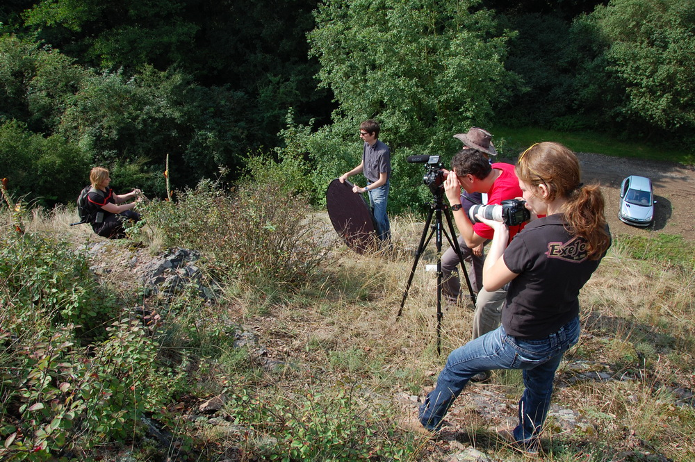 Filming crew outdoors.